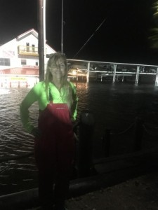 Boss Sea Hag Danielle Norwood standing across the street, showing the water level at the height of the storm surge.