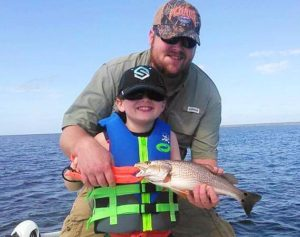Ryan Willingham and his nephew Connor found this redfish.