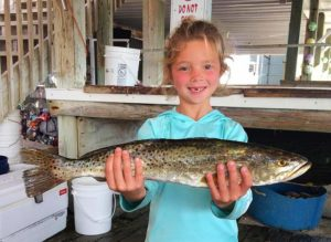 Little Addie knows where the big trout are, and it's a secret.